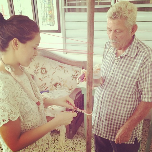 El Sr. Eustaquio Allers teaching me how to work a simple hammock weave. Photo taken at his home in Aguadilla, PR