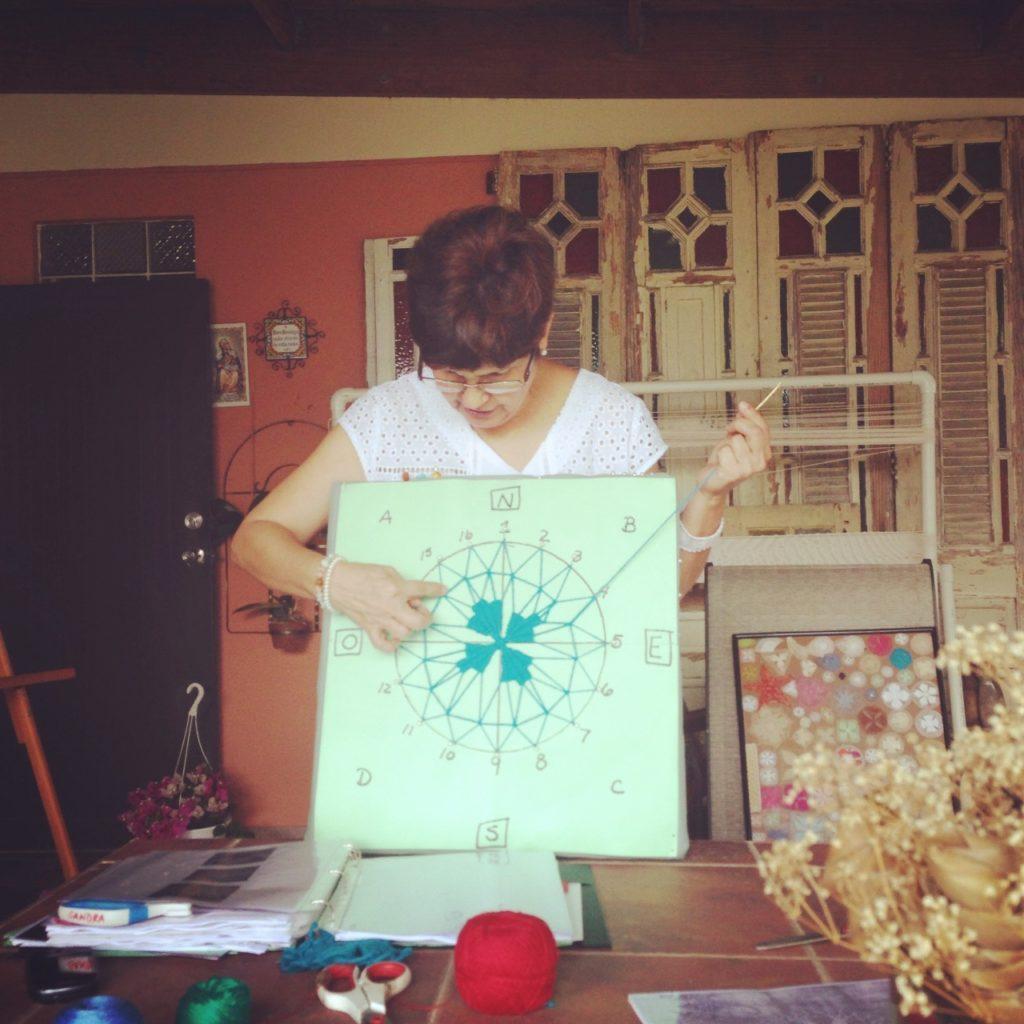Sandra Rodríguez Martínez teaching us how to make our first Sol. Photo taken at her home in Moca, PR